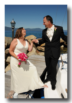 Bride and groom on the boat pier