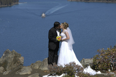 An Emerald Bay bride and groom celebrate marriage with a kiss