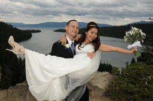 Groom carrying his happy bride