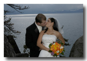 Bride and groom kissing on the vista point