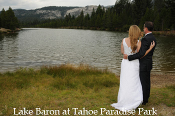 Newlyweds look out at Lake Baron at Paradise Park