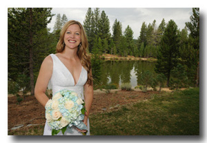 Closeup of bride in front of lake