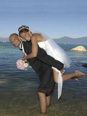 Bride riding piggyback on the groom