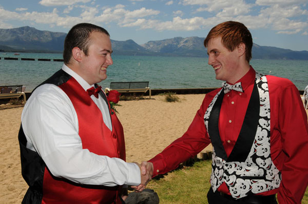 The groom shakes the hand of his best man