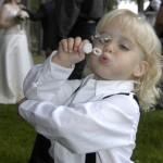Boy blows bubbles in celebration