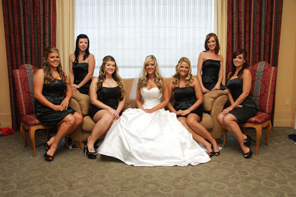 On the couch with all of her bridesmaids
