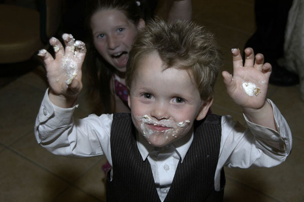 Cake icing on the hands of a boy