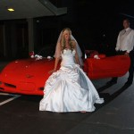 Posing by the car at night before departing the reception