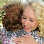 Affectionate hug from bride