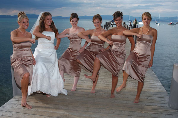 Dancing bridal party girls on the pier