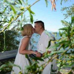 Kissing couple viewed through tree branches
