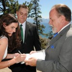 Newlyweds sign the marriage certificate