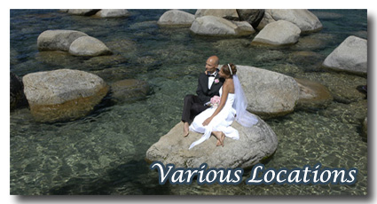 Bride and groom sitting on a rock in the water at Sand Harbor