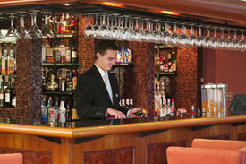 Bartender preparing to serve his guests
