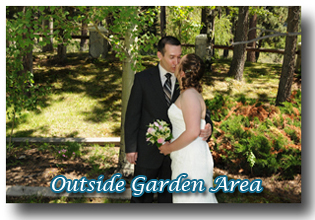Married couple embrace in the garden area