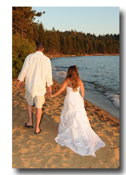 Bride and groom walking along the Tahoe shore