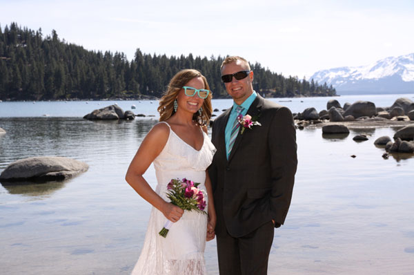 Both of the newly wedded are wearing sunglasses