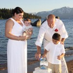 Family conducting a sand ceremony on the beach