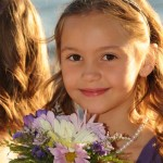 Flower girl displays a pretty smile