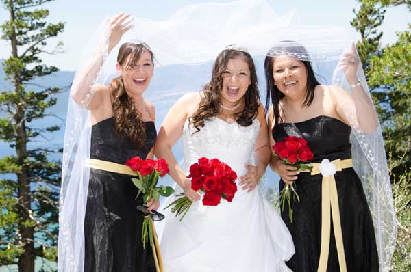 The bridal party display happy smiles