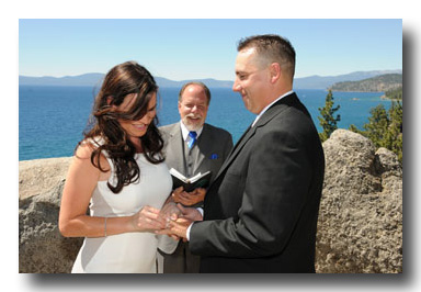 Bride and groom exchange wedding rings
