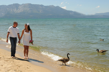 Strolling on the beach after their wedding