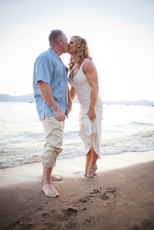 Bride and groom have first kiss on the sand