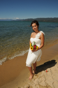 Bride posing by the water