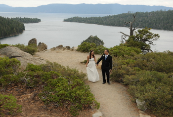 Couple holding hands at Emerald Bay