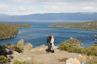 The first kiss as newlyweds standing on the bluff