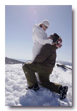 Groom kneeling by his bride on Heavenly Mountain