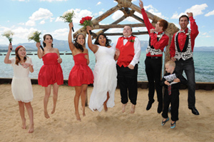 Wedding party jumping for joy