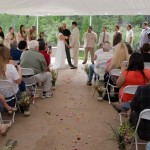 Wedding service taking place under the canopy