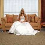 Bride sits on the couch prior to the walk