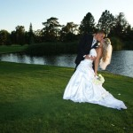 Groom dips his bride gracefully backwards
