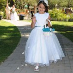 Flower girl throws her petals along the aisle