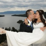 Groom holds his bride in his arms