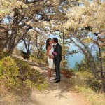 Kissing under the beautiful trees at Logan Shoals
