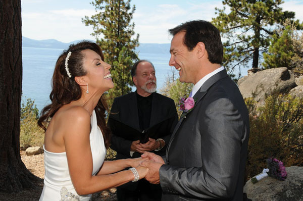 The newly married demonstrate a happy laugh