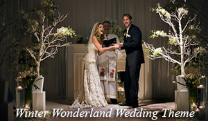 The bride and groom have fun during their winter wonderland themed ceremony