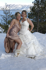 Bride with her bridesmaid in the snow
