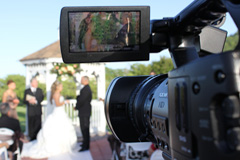 A professional videographer videotaping a wedding