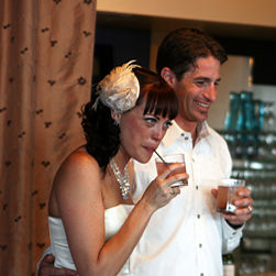 The bride and groom enjoy an alcoholic beverage at thier reception