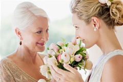 Mother of bride gazes lovingly at her daughter