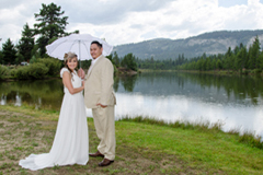 Married couple with Lake Baron in the background
