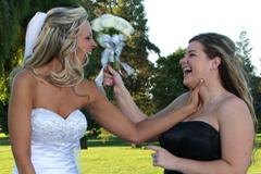 Playful bride and bridesmaid