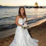 Bride poses for the photographer as the sun sets