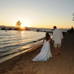 The married couple walk into the sunset after their wedding