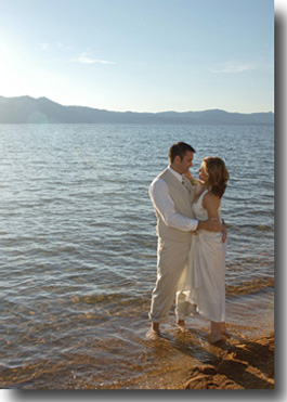 Groom standing in the water with bride